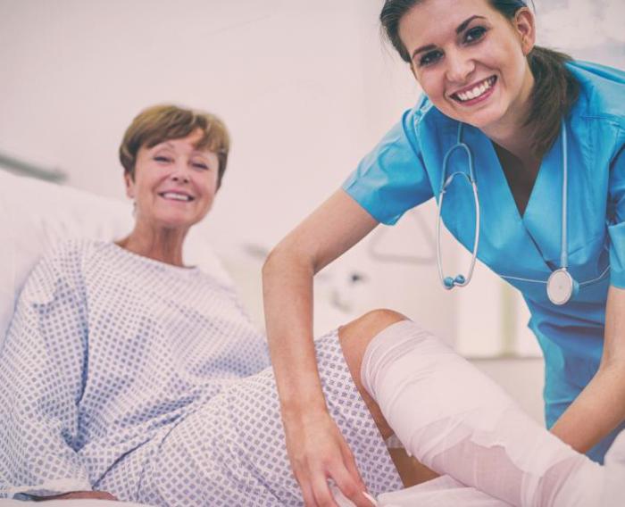 A nurse dressing a wound